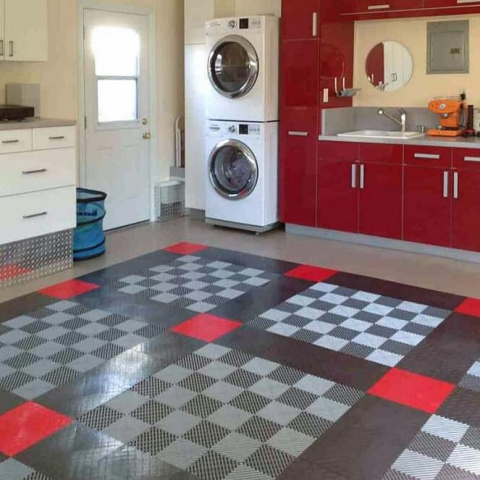 Using Free-Flow flooring over a drain is a great idea in a space with a washer and sink.