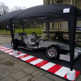 Race car tent mobile display with red and white accents