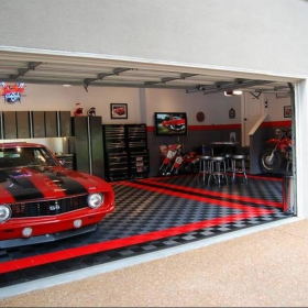 Free-Flow flooring with red accents complements this Mustang and motorbike home garage.
