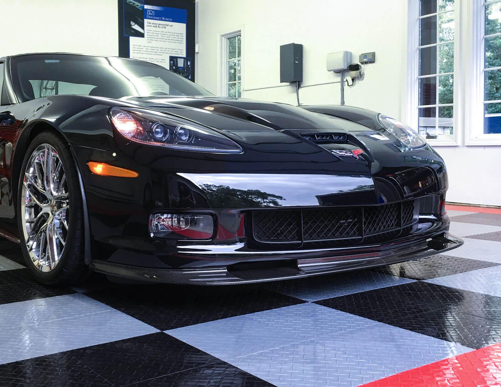 RaceDeck Diamond Tuffshield black, gray, and red showcases a black Corvette.