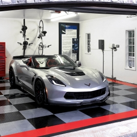 RaceDeck Diamond garage floor tile with Tuffshield in black, gray and red with a Corvette