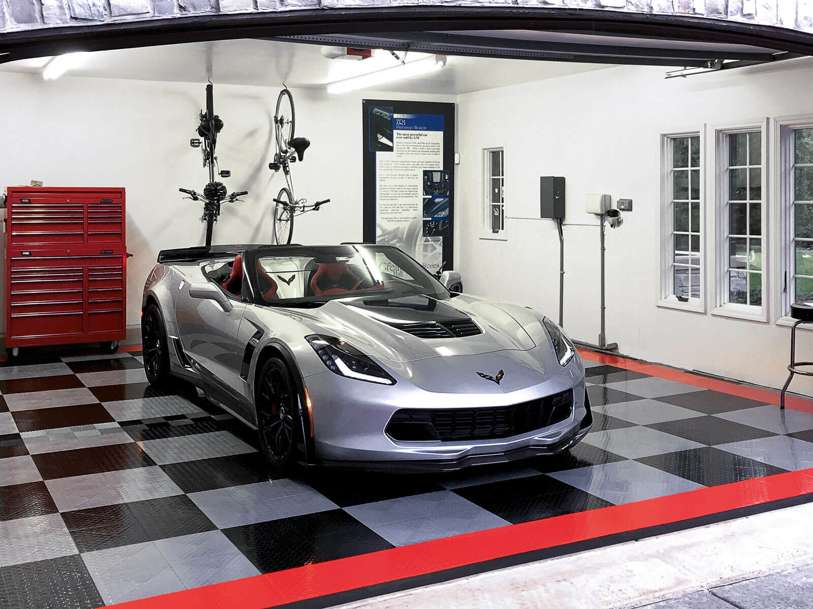 Corvette parked on RaceDeck Diamond with TuffShield flooring with edging in this home garage.