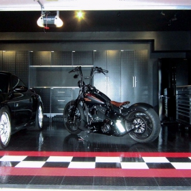 TuffShield RaceDeck high-gloss flooring looks great in this garage with a Porsche and Harley.