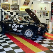 AC Cobra in a customized garage with black, white, red and yellow RaceDeck Diamond.