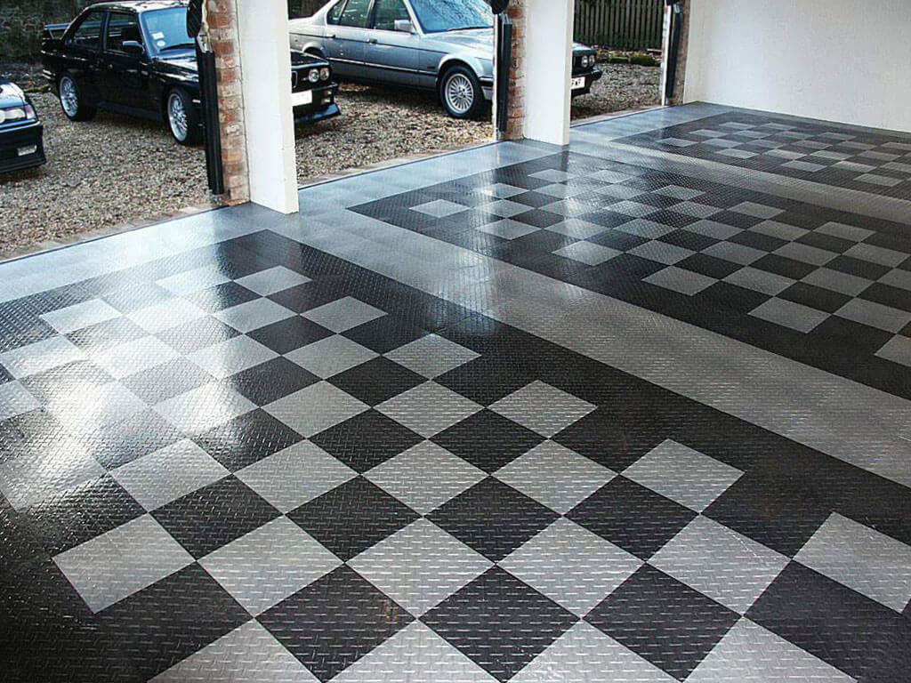 3-car garage with RaceDeck Diamond in alloy and graphite.