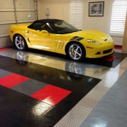 Yellow Corvette in a garage with RaceDeck Diamond and RaceDeck Pro tiles.