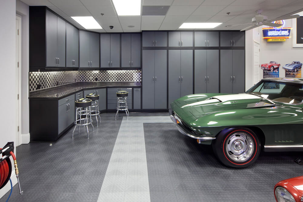 Green Corvette in a garage with graphite and alloy CircleTrac flooring.