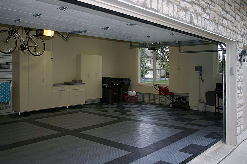 Home garage with RaceDeck Diamond alloy and graphite flooring.