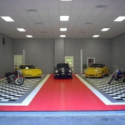 Porsches, Corvette and motorcycles on display with RaceDeck Diamond in black, graphite, red and white.