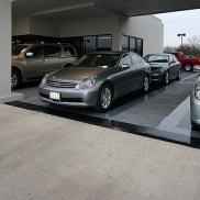 Infiniti dealer display featuring Snap-Carpet and RaceDeck Diamond flooring.