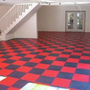 Garage interior with RaceDeck Diamond red and graphite flooring.