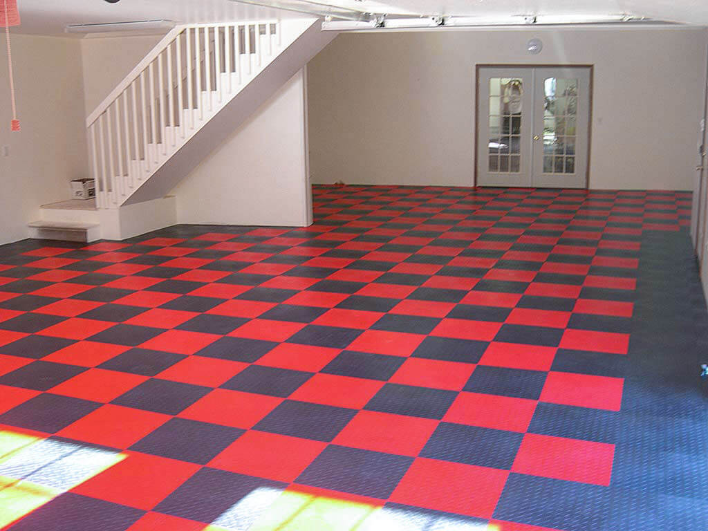Garage interior with RaceDeck Diamond red and graphite flooring.