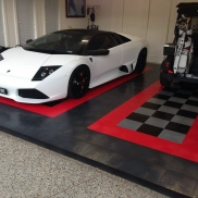 Lamborghini and golf cart in a garage with RaceDeck Diamond in alloy, black, red and graphite.
