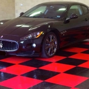 Maserati on black and red RaceDeck XL flooring.