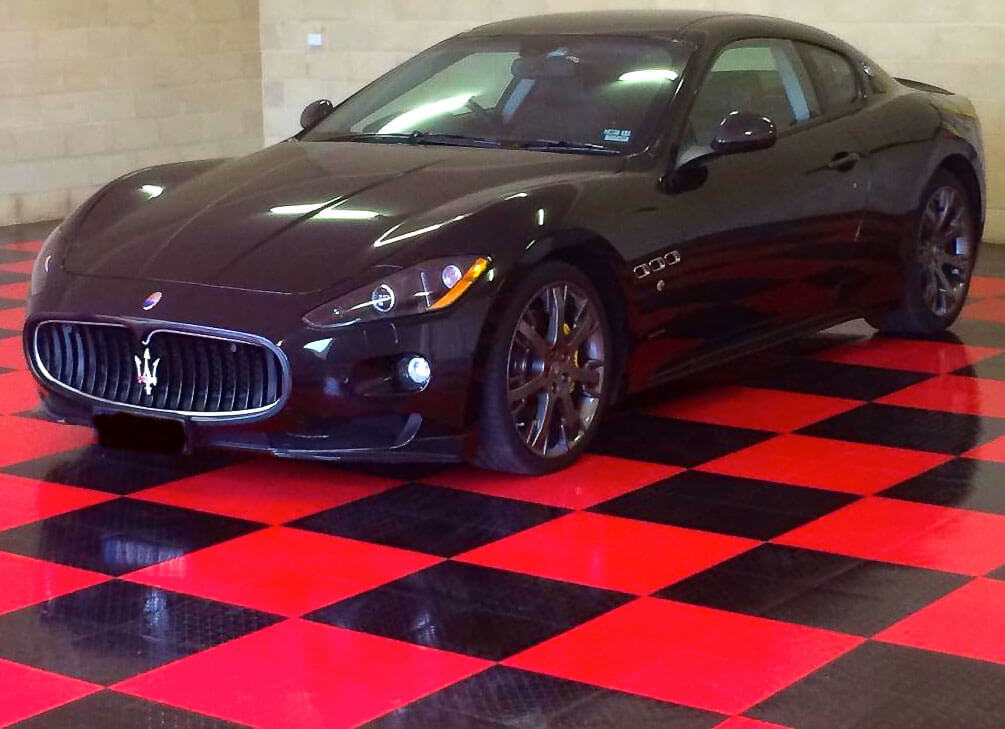 Maserati on black and red RaceDeck XL flooring.