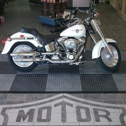 Motorcycle pad display using RaceDeck XL in graphite and alloy.