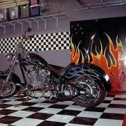 Motorcycle on a checkered CircleTrac floor.