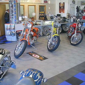 Motorcycles on RaceDeck Diamond flooring in this retail display.