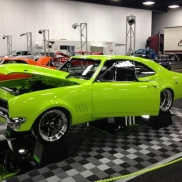 Parking pads with Free-Flow alloy and graphite for muscle car displays.