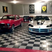 Mustang and Porsche in a garage with RaceDeck Diamond alloy, black, and red flooring.