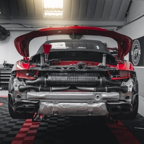 Porsche 911 Turbo S in shop with black and red Free-Flow