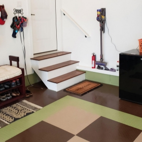 RaceDeck Diamond in beige, green light and espresso colors in a mud room