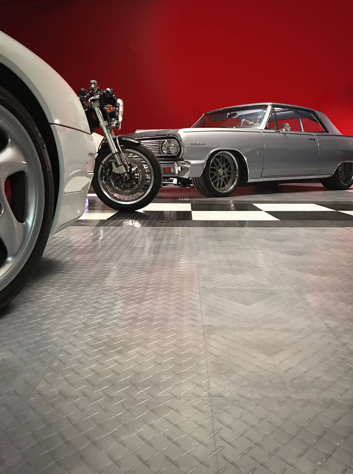 RaceDeck Speed Garage vehicle display using RaceDeck Diamond flooring. Check out the Maliboost!