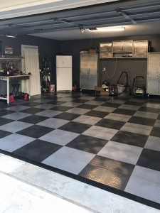 RaceDeck Diamond in graphite and alloy complement the silver cabinets in this garage.
