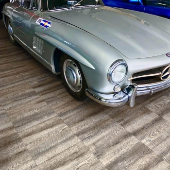 A garage with Smoked Oak and a Mercedes-Benz 300 SL gullwing.