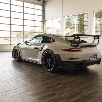 A Porsche GT2 RS parked on Smoked Oak display flooring