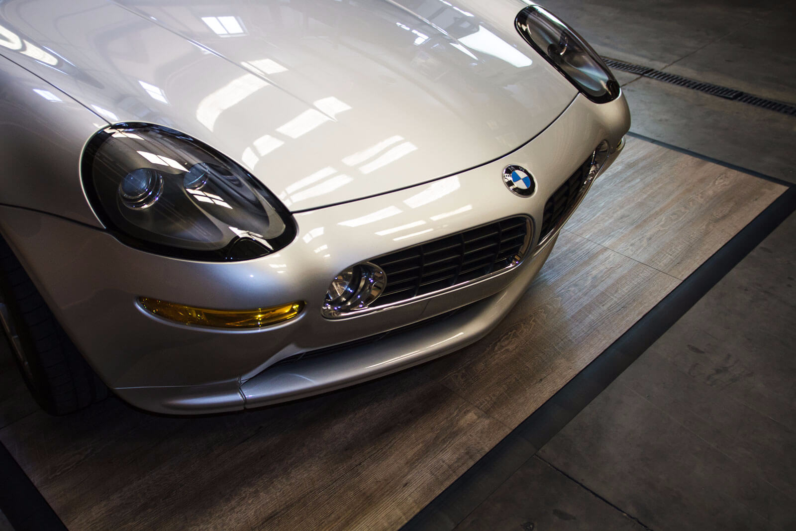 A close up of RaceDeck's Smoked Oak with a BMW displayed on it.