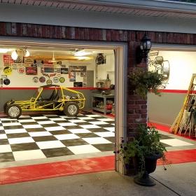 RaceDeck Diamond™ garage tile flooring and red edging.