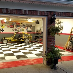 Looking in at a garage with RaceDeck Diamond™ flooring and red edging.
