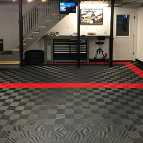 Basement-garage space with Free-Flow flooring in black, graphite, and red.