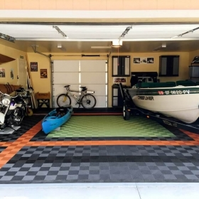 Bikes and boats in this garage with self-draining Free-Flow in graphite, black, orange and green light.