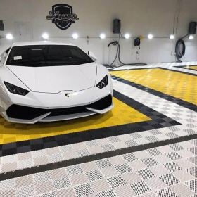 Lambo on self-draining Free-Flow garage flooring in white, black and yellow at Lusso Auto Spa.