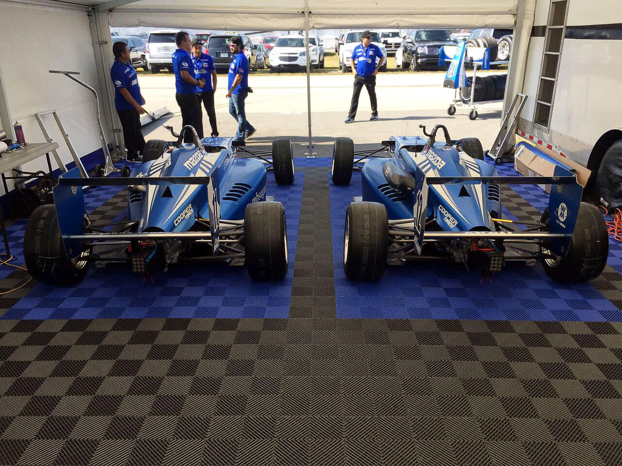 """Black and royal blue Free-Flow in this racing tent. <a href=""""http://racedeck.com/racedeck-products/free-flow/"""">Click here for more about Free-Flow.</a>"""