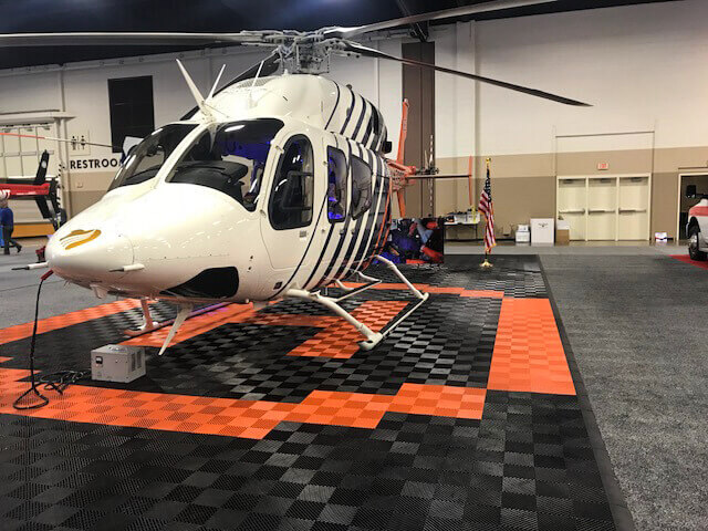 """Helicopter pad display with Free-Flow black and orange. <a href=""""http://racedeck.com/racedeck-products/free-flow/"""">Click here for more about Free-Flow.</a>"""