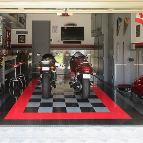 Suzuki motorcycles in a garage with RaceDeck Diamond alloy, black and red flooring.