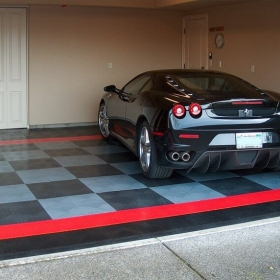 """Mustang in a garage with RaceDeck Diamond flooring and edging. <a href=""""http://racedeck.com/racedeck-products/racedeck-diamond/"""">Click here for more about RaceDeck Diamond.</a>"""