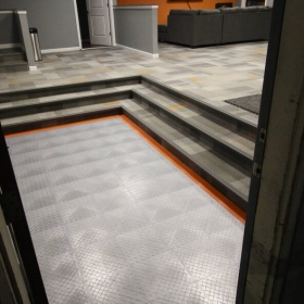 RaceDeck Diamond floor accent with alloy and orange.