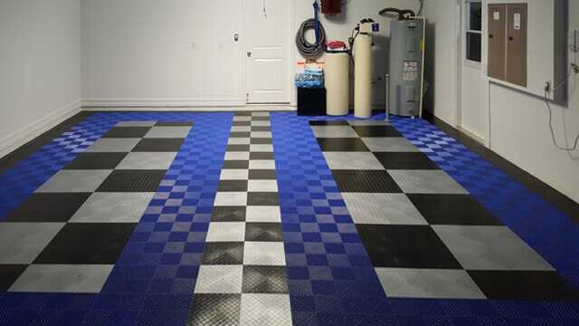 """Checkered RaceDeck Diamond accents the royal blue Free-Flow flooring. Free-Flow is a great choice for this area because of its self-draining open design. <a href=""""http://racedeck.com/racedeck-products/free-flow/"""">Click here for more about Free-Flow.</a>"""