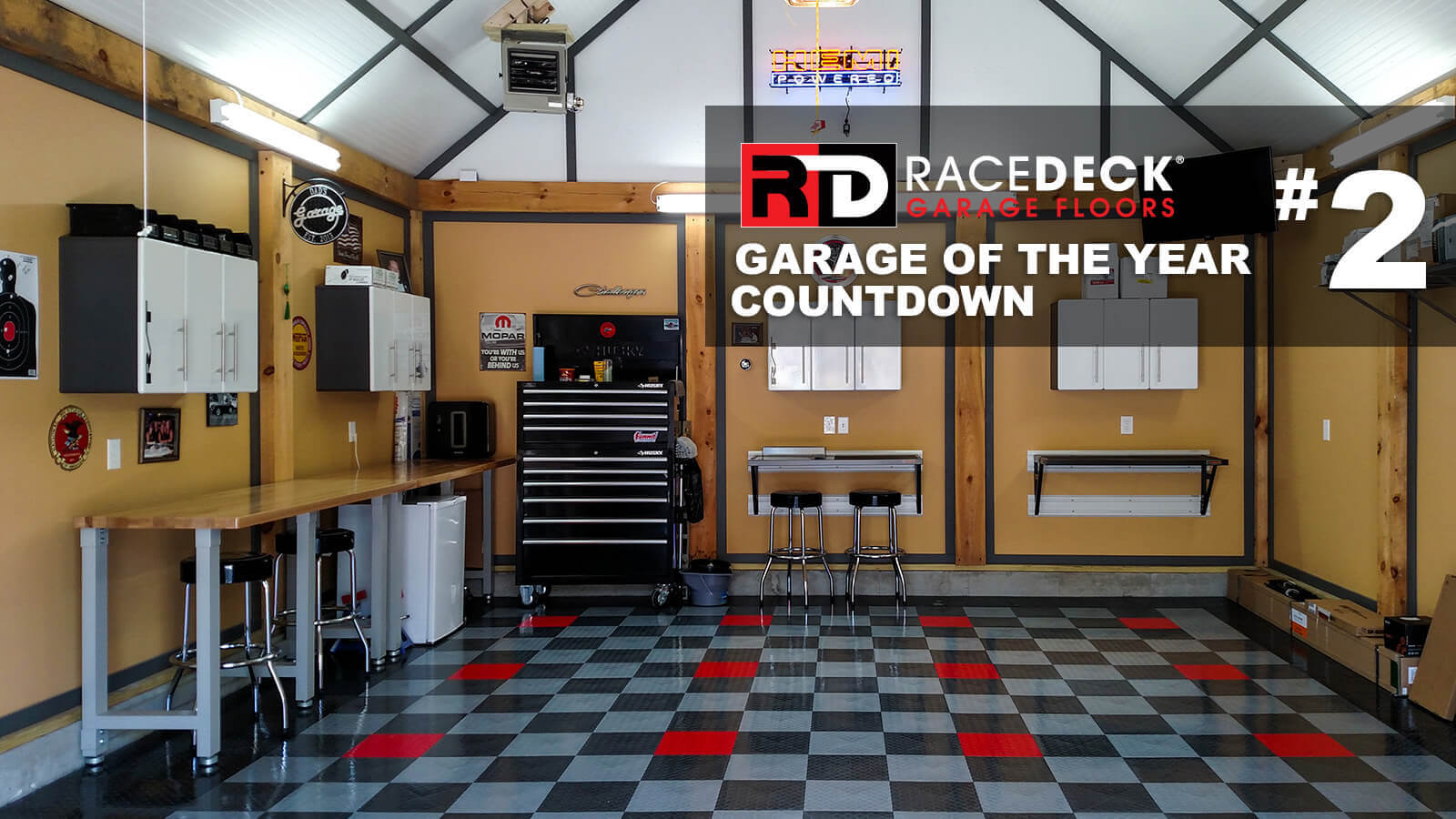 This wood-accented detached garage design is great with the checkered RaceDeck Diamond Tuffshield<sup>®</sup> flooring.