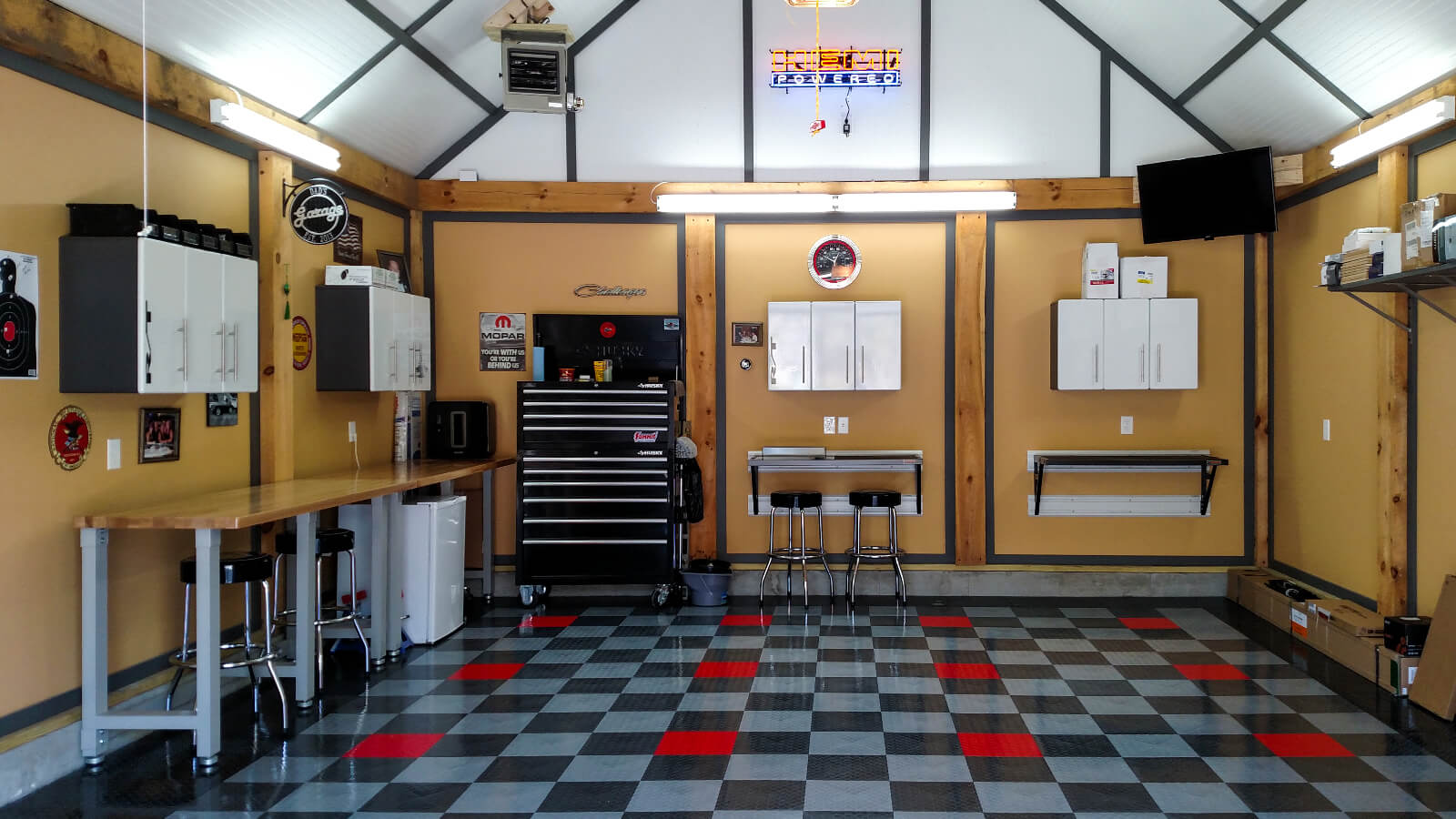 RaceDeck Diamond black, alloy and graphite checkered garage floor with red accents.