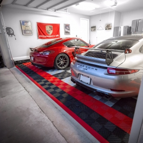 A Porsche garage completed with three striking colors of Free-Flow flooring. Custom red edging ties the look together.