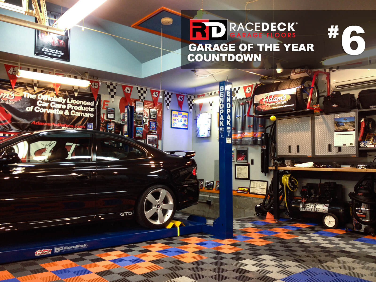 This colorful garage features Free-Flow<sup>®</sup> flooring in Alloy, Graphite, Orange, and Royal Blue.