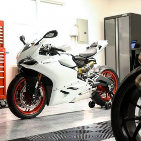 Motorcycles in this garage with RaceDeck Diamond and a stripe of Free-Flow self-draining flooring.