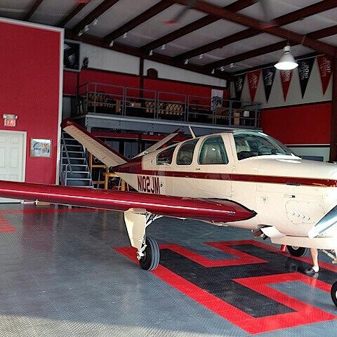 RaceDeck Diamond alloy, black and red with custom H pattern, hangar flooring.