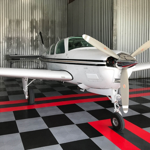 Airplane hangar with RaceDeck Diamond, custom stripes for perfect alignment.