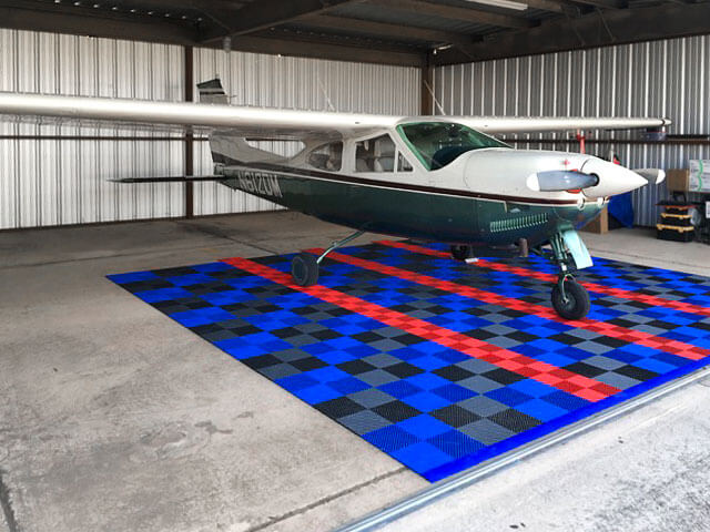 Free-Flow XL and regular Free-Flow parking pad for a plane hangar.
